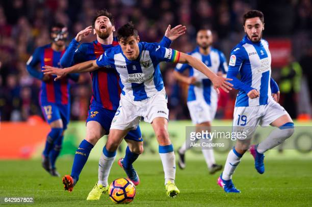 Lionel Messi of FC Barcelona fights for the ball with Martin Maximiliano Mantovani of CD Leganes during the La Liga match between FC Barcelona and CD...