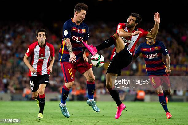 Lionel Messi of FC Barcelona fights for the ball with Mikel Balenziaga of Athletic Club during the Spanish Super Cup second leg match between FC...