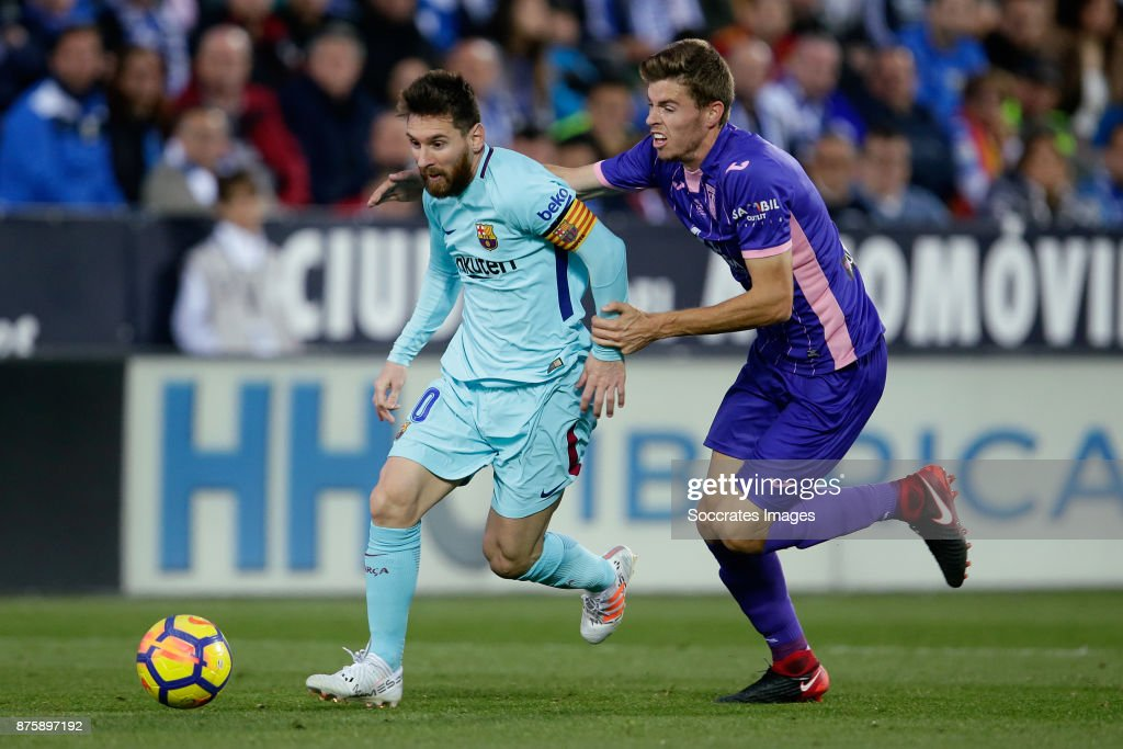 Lionel Messi of FC Barcelona, Gerard of Leganes during the Spanish Primera Division match between Leganes v FC Barcelona at the Estadio Municipal de Butarque on November 18, 2017 in Madrid Spain