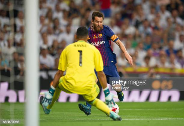 Lionel Messi of FC Barcelona gets his shot on goal blocked by Keylor Navas of Real Madrid CF during the Supercopa de Espana Final 2nd Leg match...