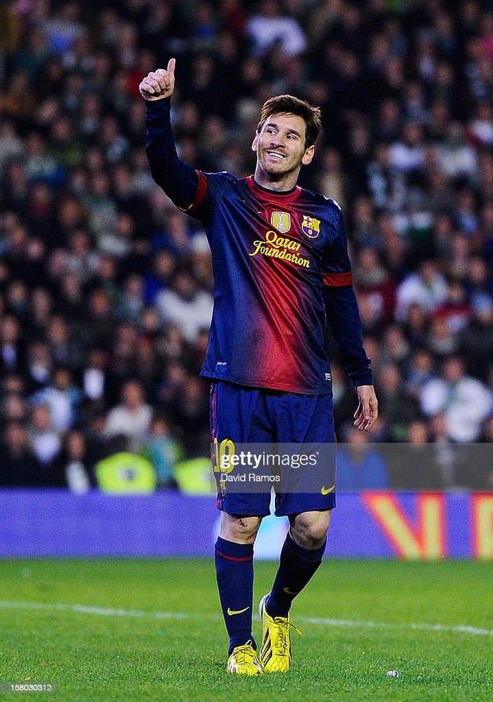 <a gi-track='captionPersonalityLinkClicked' href=/galleries/search?phrase=Lionel+Messi&family=editorial&specificpeople=453305 ng-click='$event.stopPropagation()'>Lionel Messi</a> of FC Barcelona gives his thumbs up during the La Liga match between Real Betis Balompie and FC Barcelona at Estadio Benito Villamarin on December 9, 2012 in Seville, Spain.