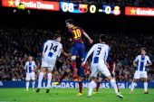 Lionel Messi of FC Barcelona heads the ball towards goal during the La Liga match between FC Barcelona and RCD Espanyol at Camp Nou on November 1...