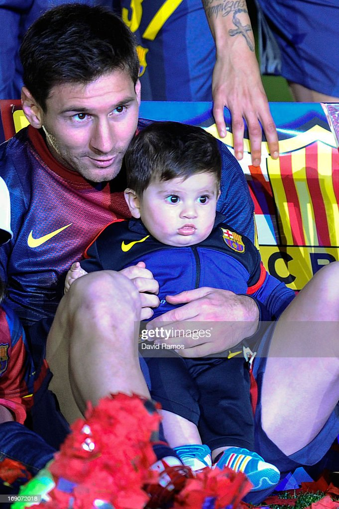 Lionel Messi of FC Barcelona holds his son Thiago during the celebration after winning the Spanish League after the La Liga match between FC Barcelona and Real Valladolid CF at Camp Nou on May 19, 2013 in Barcelona, Spain.