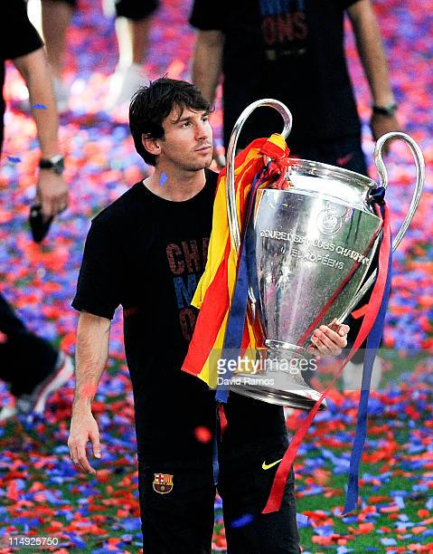 Lionel Messi of FC Barcelona holds the UEFA Champions League Trophy during the celebrations after winning the UEFA Champions League Final against...