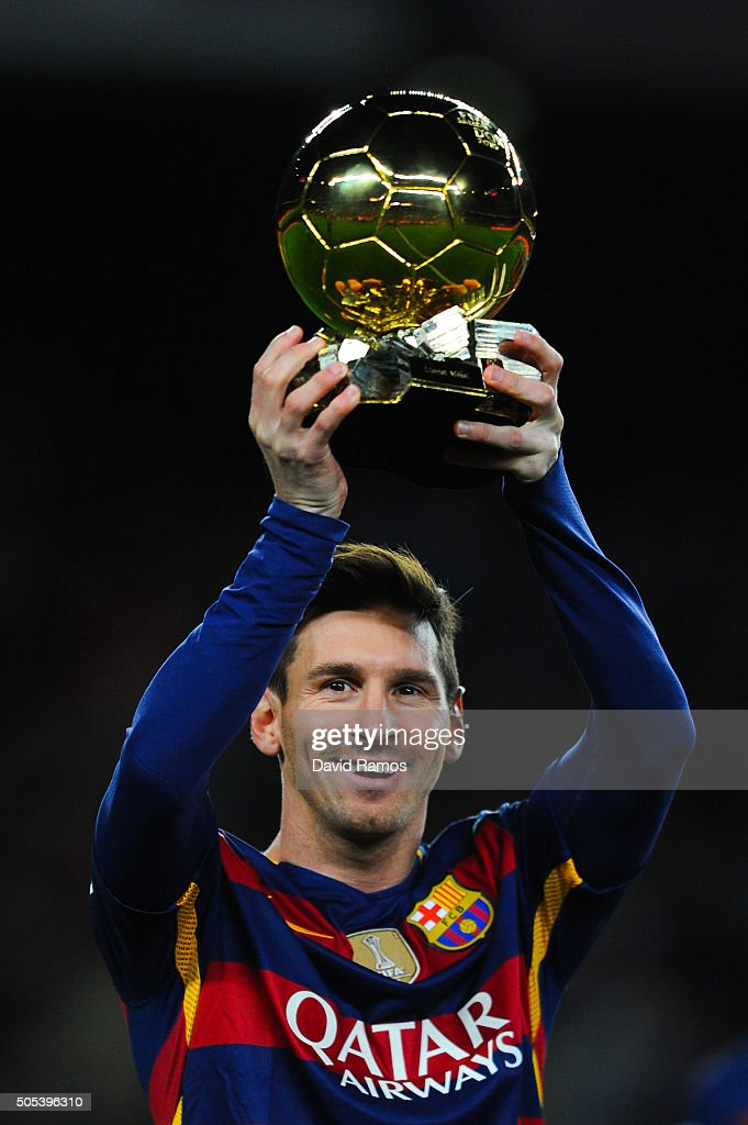 <a gi-track='captionPersonalityLinkClicked' href=/galleries/search?phrase=Lionel+Messi&family=editorial&specificpeople=453305 ng-click='$event.stopPropagation()'>Lionel Messi</a> of FC Barcelona holds up the FIFA Ballon d'Or trophy prior to the La Liga match between FC Barcelona and Athletic Club de Bilbao at Camp Nou on January 17, 2016 in Barcelona, Spain.