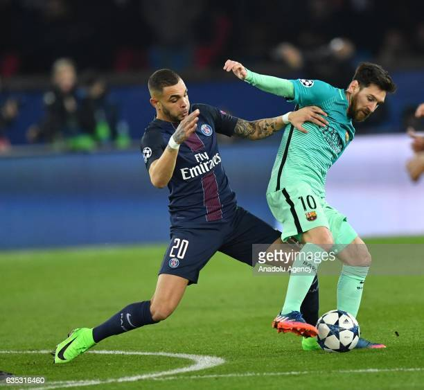 Lionel Messi of FC Barcelona in action against Layvin Kurzawa of Paris SaintGermain during the UEFA Champions League round of 16 match between Paris...