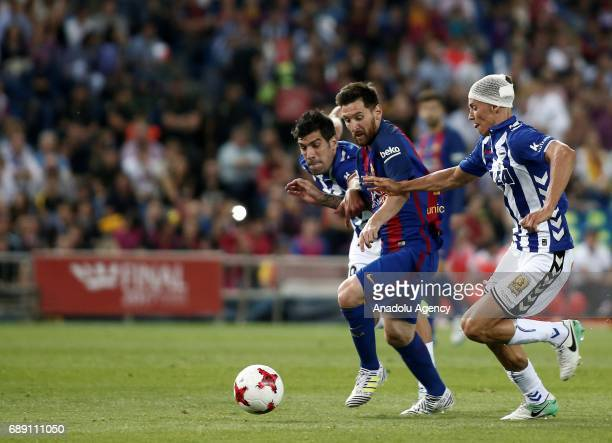 Lionel Messi of FC Barcelona in action against Marcos Llorente during the Copa Del Rey Final between FC Barcelona and Deportivo Alaves at Vicente...