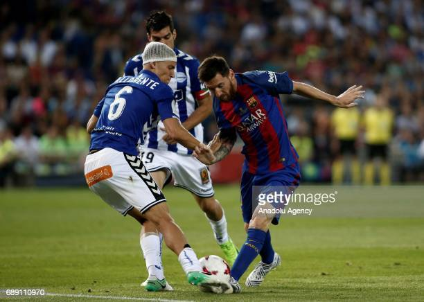 Lionel Messi of FC Barcelona in action against Marcos Llorente of Deportivo Alaves during the Copa Del Rey Final between FC Barcelona and Deportivo...