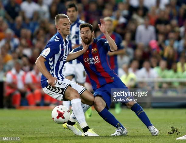 Lionel Messi of FC Barcelona in action against Rodrigo Ely during the Copa Del Rey Final between FC Barcelona and Deportivo Alaves at Vicente...