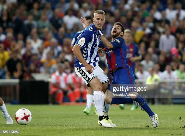 Lionel Messi of FC Barcelona in action against Rodrigo Ely of Deportivo Alaves during the Copa Del Rey Final between FC Barcelona and Deportivo...