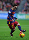 Lionel Messi of FC Barcelona in action during the La Liga match between Sporting Gijon and FC Barcelona at Estadio El Molinon on February 17 2016 in...