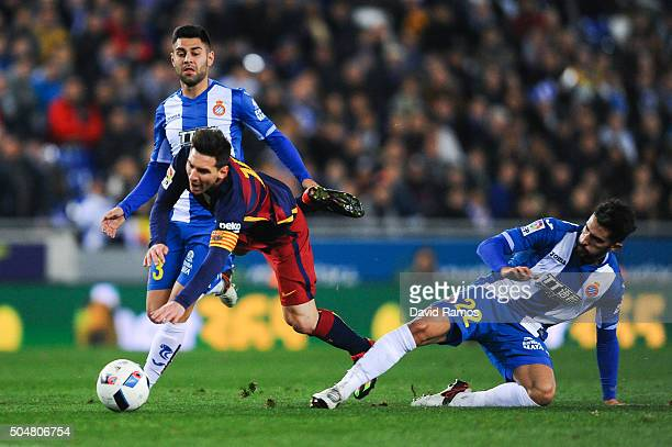 Lionel Messi of FC Barcelona is brought down by Alvaro Gonzalez of RCD Espanyol during the Copa del Rey Round of 16 second leg match between RCD...