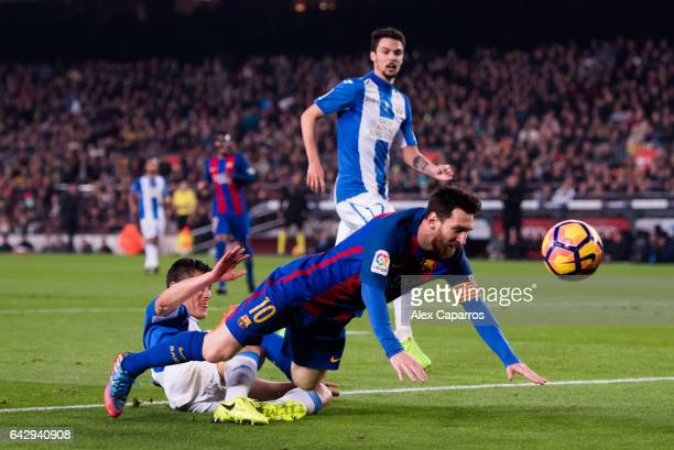 Lionel Messi of FC Barcelona is brought down by Martin Maximiliano Mantovani of CD Leganes during the La Liga match between FC Barcelona and CD...