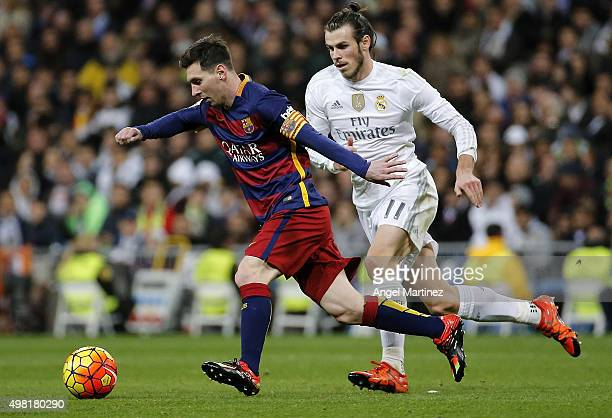 Lionel Messi of FC Barcelona is chased by Gareth Bale of Real Madrid during the La Liga match between Real Madrid CF and FC Barcelona at Estadio...