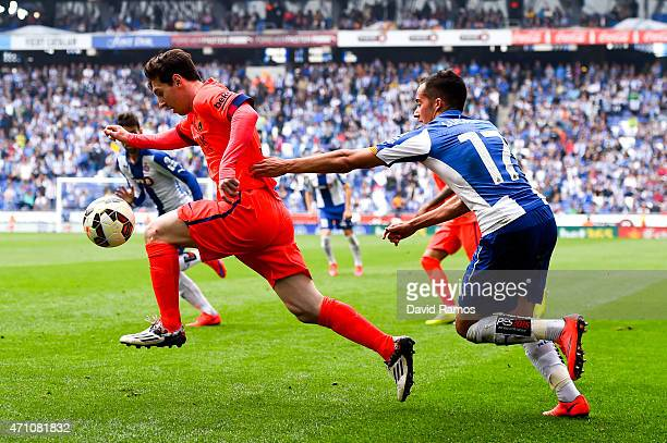 Lionel Messi of FC Barcelona is chased down by Lucas Vazquez of RCD Espanyol during the La Liga match between RCD Espanyol and FC Barcelona at...
