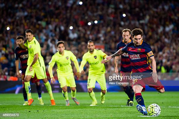 Lionel Messi of FC Barcelona kicks a penalty shot and scores his team's third goal during the La Liga match between FC Barcelona and Levante UD at...