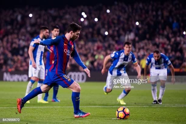 Lionel Messi of FC Barcelona kicks a penalty shot and scores his team's second goal during the La Liga match between FC Barcelona and CD Leganes at...