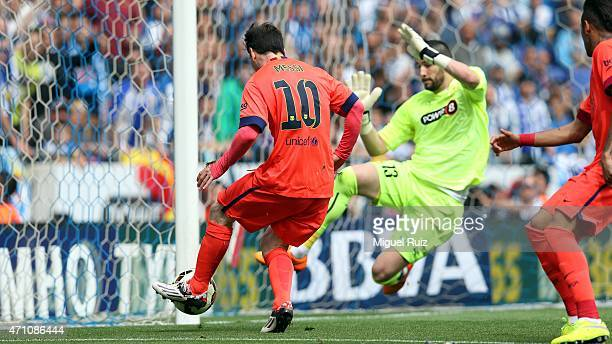 Lionel Messi of FC Barcelona kicks the ball and scores the second goal during the La Liga match between RCD Espanyol and FC Barcelona at CornellaEl...