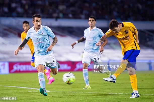 Lionel Messi of FC Barcelona kicks the ball during the La Liga match between Celta Vigo and FC Barcelona at Estadio Balaidos on September 23 2015 in...