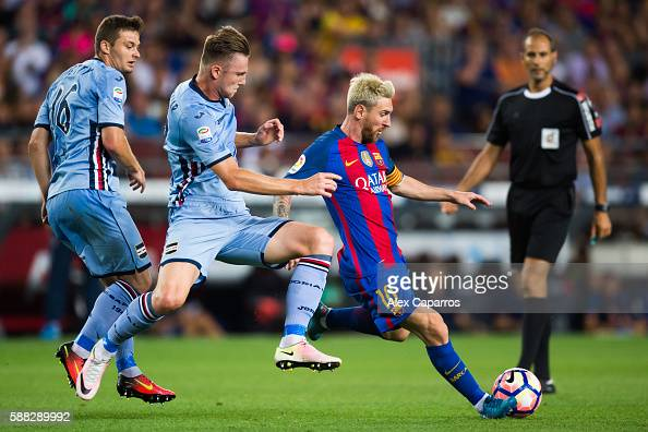 Lionel Messi of FC Barcelona kicks the ball next to Milan Skriniar and ...