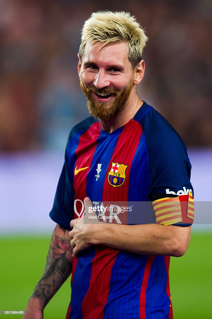Lionel Messi of FC Barcelona laughs after the Spanish Super Cup Final second leg match between FC Barcelona and Sevilla FC at Camp Nou on August 17...