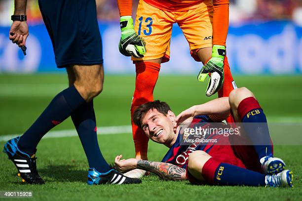Lionel Messi of FC Barcelona lays injured during the La Liga match between FC Barcelona and UD Las Palmas at Camp Nou on September 26 2015 in...