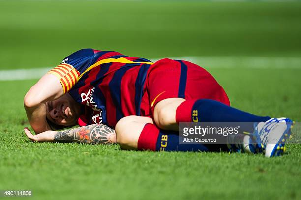 Lionel Messi of FC Barcelona lays injured on the pitch during the La Liga match between FC Barcelona and UD Las Palmas at Camp Nou on September 26...