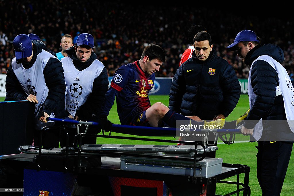 Lionel Messi of FC Barcelona leaves the pitch on a stretcher after being injured during the UEFA Champions League Group G match between FC Barcelona and SL Benfica at Nou Camp on December 5, 2012 in Barcelona, Spain.