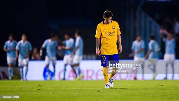 Lionel Messi of FC Barcelona looks dejected after Iago Aspas of Celta Vigo scored his team's fourth goal during the La Liga match between Celta Vigo...