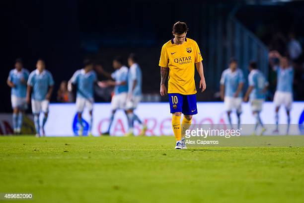 Lionel Messi of FC Barcelona looks dejected after John Guidetti of Celta Vigo scored his team's fourth goal during the La Liga match between Celta...