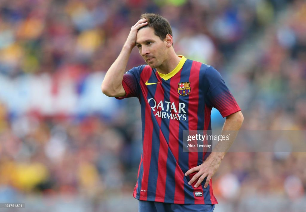Lionel Messi of FC Barcelona looks dejected during the La Liga match between FC Barcelona and Club Atletico de Madrid at Camp Nou on May 17, 2014 in Barcelona, Spain.