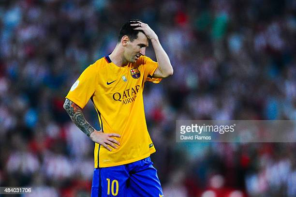 Lionel Messi of FC Barcelona looks down dejected during the Spanish Super Cup first leg match between FC Barcelona and Athletic Club at San Mames...