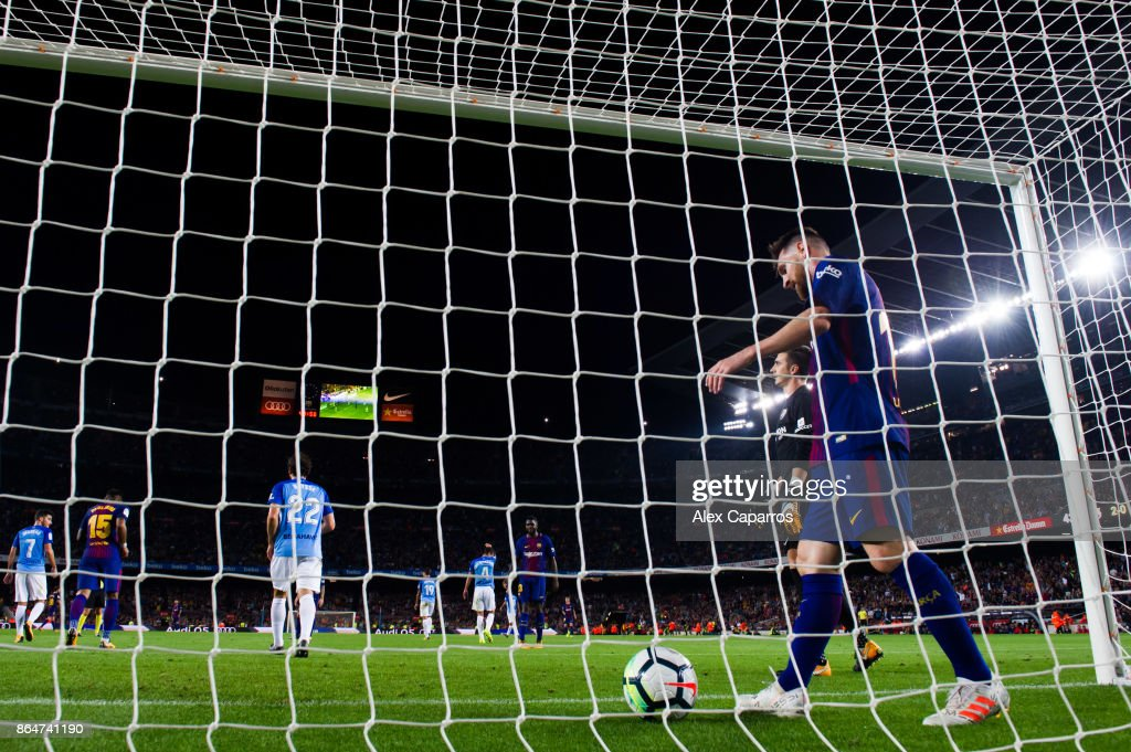 Lionel Messi of FC Barcelona looks on after scoring a disallowed goal during the La Liga match between Barcelona and Malaga at Camp Nou on October 21, 2017 in Barcelona, Spain.