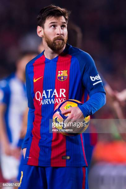 Lionel Messi of FC Barcelona looks on before kicking a penalty shot and scoring his team's second goal during the La Liga match between FC Barcelona...