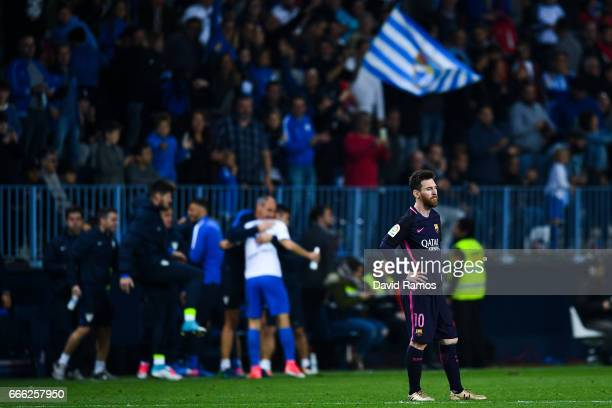 Lionel Messi of FC Barcelona looks on dejected after Jony Rodriguez of Malaga CF scored his team's second goal during the La Liga match between...