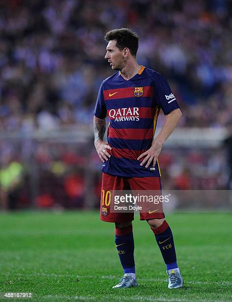 Lionel Messi of FC Barcelona looks on during the La Liga match between Club Atletico de Madrid and FC Barcelona at Vicente Calderon Stadium on...