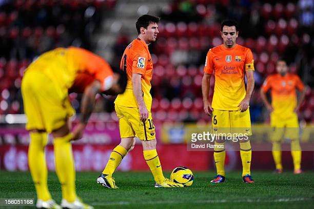 Lionel Messi of FC Barcelona looks on during the La Liga match between RCD Mallorca and FC Barcelona at Iberostar Stadium on November 11 2012 in...
