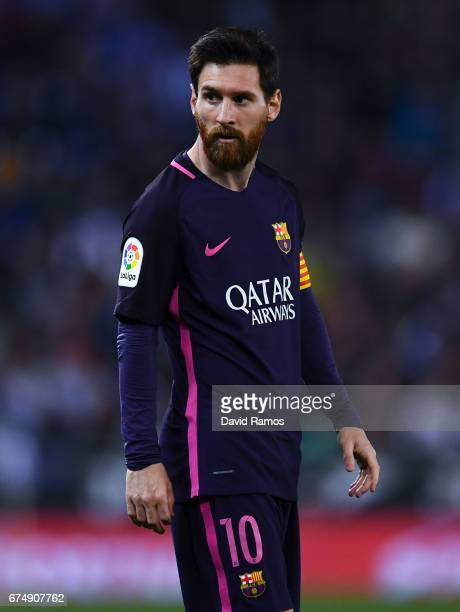 Lionel Messi of FC Barcelona looks on during the La Liga match between RCD Espanyol and FC Barcelona at the RCDE Stadium on April 29 2017 in...
