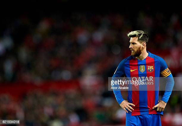 Lionel Messi of FC Barcelona looks on during the match between Sevilla FC vs FC Barcelona as part of La Liga at Ramon Sanchez Pizjuan Stadium on...