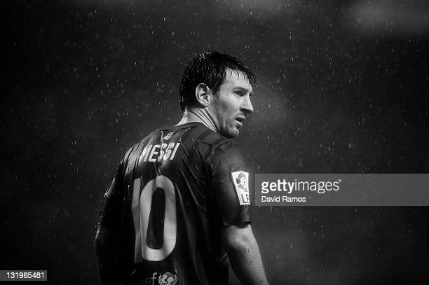 Lionel Messi of FC Barcelona looks on under a heavy rain storm during the La Liga match between Athletic Club and FC Barcelona at San Mames Stadium...