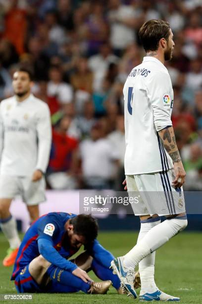 Lionel Messi of FC Barcelona on the ground during the La Liga match between Real Madrid CF and FC Barcelona at the Santiago Bernabeu stadium on April...