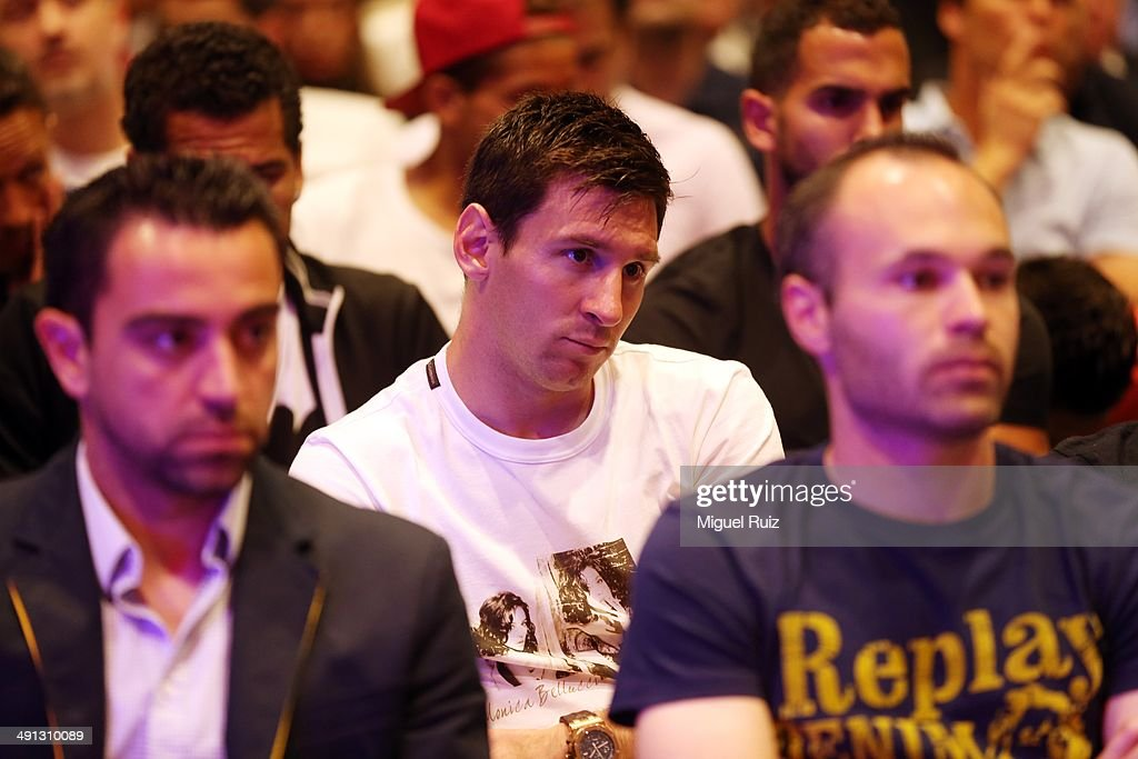 Lionel Messi (C) of FC Barcelona pays attention during the farewell press conference as Puyol leaves FC Barcelona at the Auditorium 1899 on May 15, 2014 in Barcelona, Spain.
