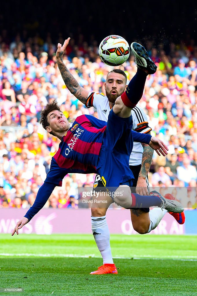 <a gi-track='captionPersonalityLinkClicked' href=/galleries/search?phrase=Lionel+Messi&family=editorial&specificpeople=453305 ng-click='$event.stopPropagation()'>Lionel Messi</a> of FC Barcelona performs an overhead kick under a challenge by <a gi-track='captionPersonalityLinkClicked' href=/galleries/search?phrase=Nicolas+Otamendi&family=editorial&specificpeople=5863368 ng-click='$event.stopPropagation()'>Nicolas Otamendi</a> of Valencia CF during the La Liga match between FC Barcelona and Valencia CF at Camp Nou on April 18, 2015 in Barcelona, Spain.