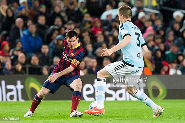 Lionel Messi of FC Barcelona plays of the ball among Andreu Fontas of RC Celta de Vigo during the La Liga match between FC Barcelona and RC Celta de...