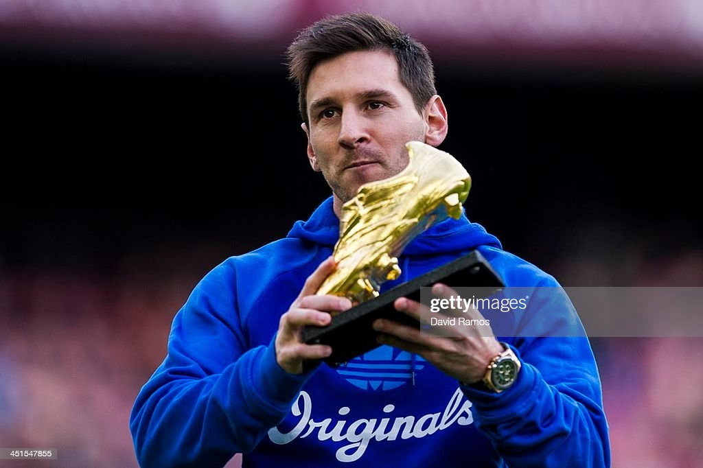 <a gi-track='captionPersonalityLinkClicked' href=/galleries/search?phrase=Lionel+Messi&family=editorial&specificpeople=453305 ng-click='$event.stopPropagation()'>Lionel Messi</a> of FC Barcelona poses the Golden Boot for scoring 46 goals last season prior to the La Liga match between FC Barcelona and Granda CF at Camp Nou on November 23, 2013 in Barcelona, Spain.