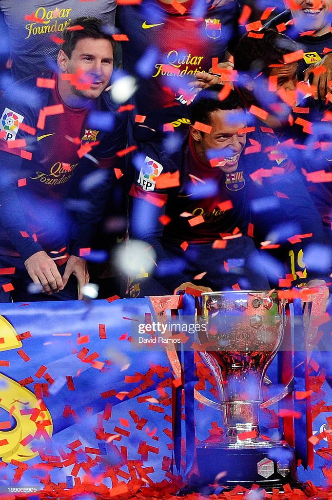 FC <a gi-track='captionPersonalityLinkClicked' href=/galleries/search?phrase=Lionel+Messi&family=editorial&specificpeople=453305 ng-click='$event.stopPropagation()'>Lionel Messi</a> of FC Barcelona poses with the trophy during the celebration after winning the Spanish League after the La Liga match between FC Barcelona and Real Valladolid CF at Camp Nou on May 19, 2013 in Barcelona, Spain.