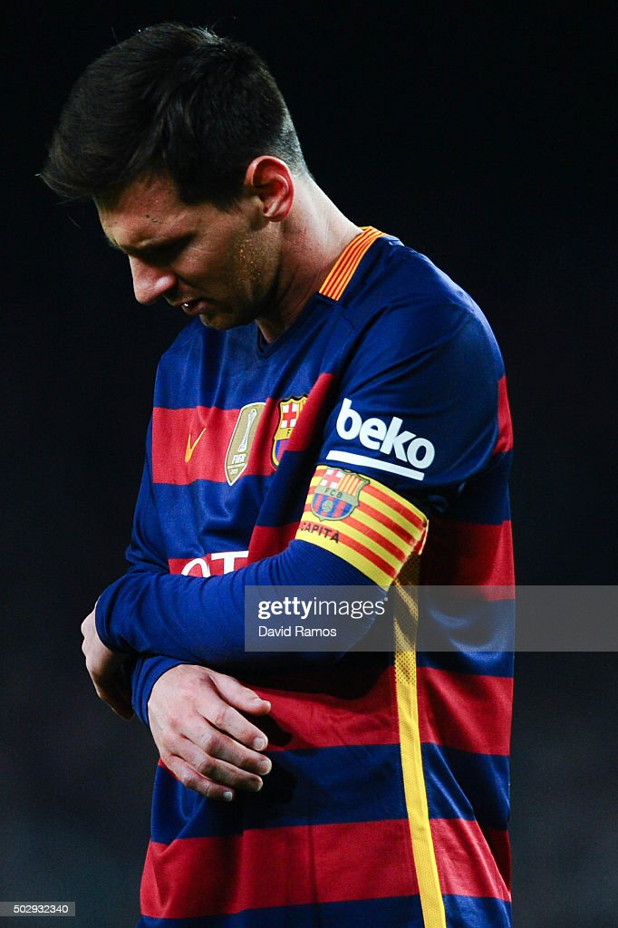 Lionel Messi of FC Barcelona reacts after clashing with Adan the La Liga match between FC Barcelona and Real Betis Balompie at Camp Nou on December...