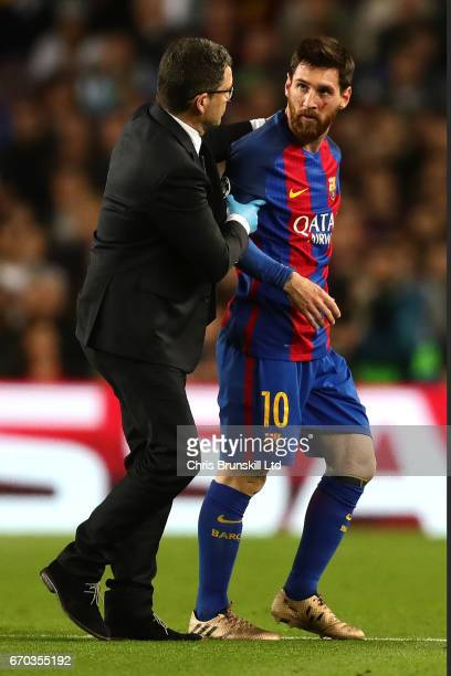 Lionel Messi of FC Barcelona receives treatment for a cut during the UEFA Champions League Quarter Final second leg match between FC Barcelona and...