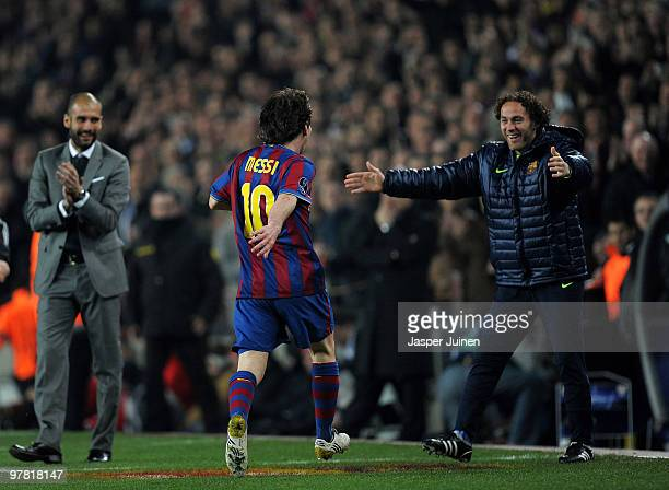Lionel Messi of FC Barcelona runs in celebration towards his teammate Gabriel Milito and head coach Josep Guardiola after scoring his sides third...