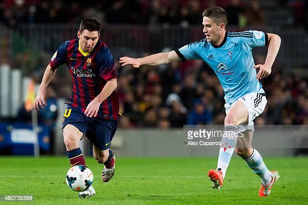 Lionel Messi of FC Barcelona runs with the ball close to Andreu Fontas of RC Celta de Vigo during the La Liga match between FC Barcelona and RC Celta...
